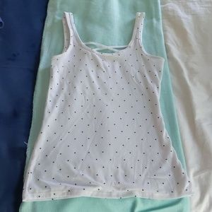 White tank top with black polka dots.